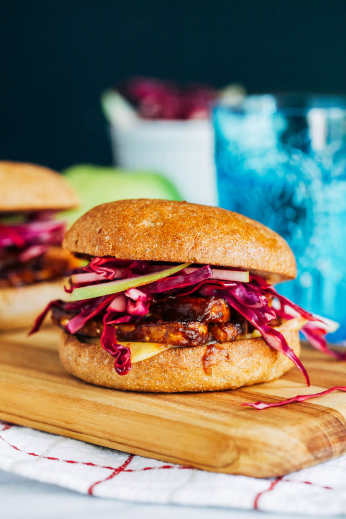 BBQ Tempeh Sandwiches with Tangy Apple Slaw- barbecue tempeh topped with vegan smoked gouda and a tangy apple slaw. The perfect summer sandwich!