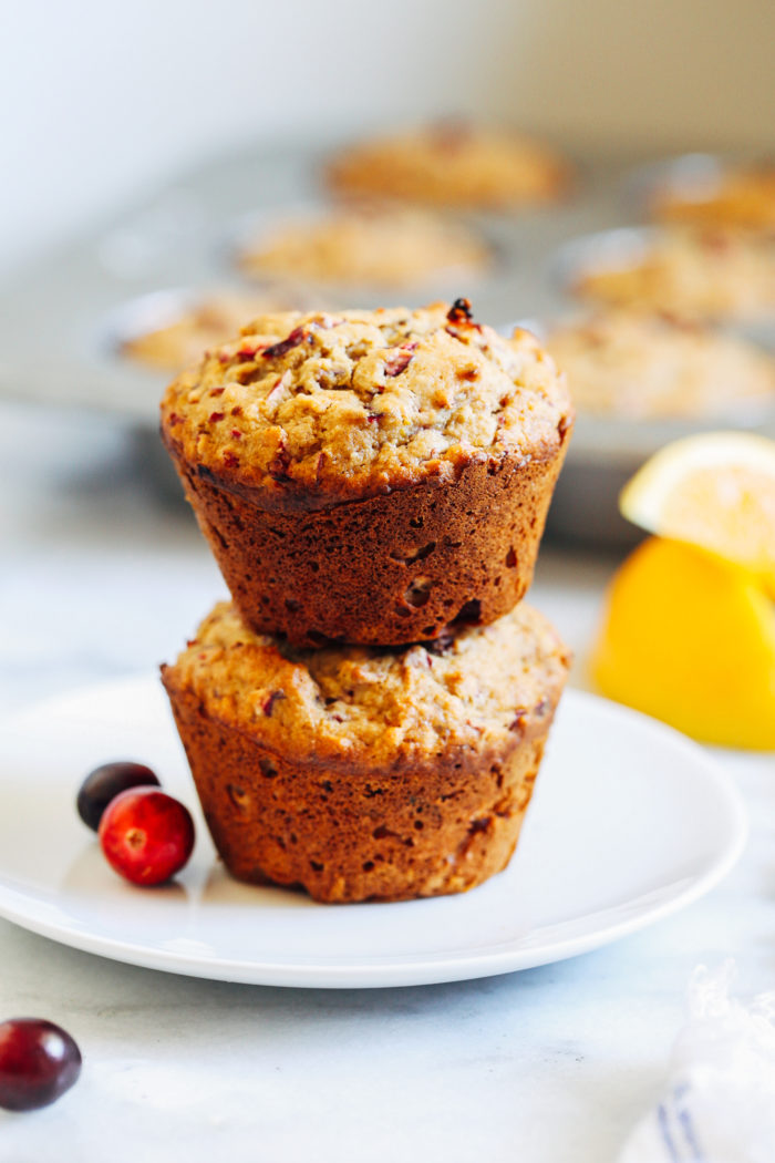 Gluten-free Cranberry Orange Muffins- made with a combination of wholesome gluten-free flours, these naturally sweetened muffins are bursting with flavor from fresh cranberries and orange zest.(vegan option)
