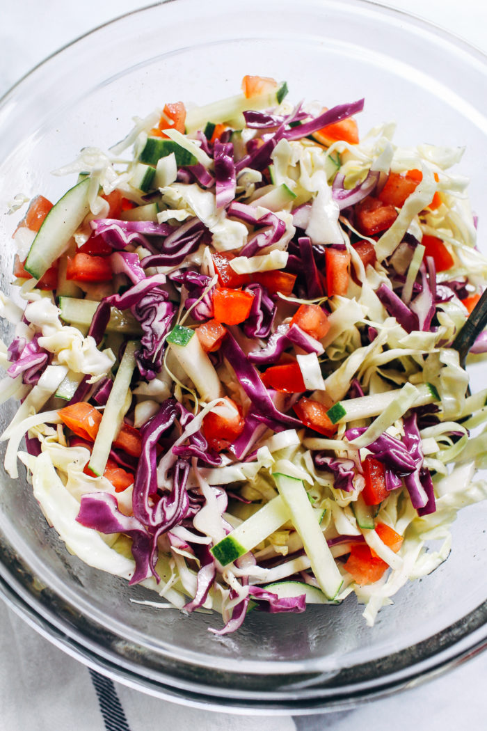 Cucumber Tomato Coleslaw- tangy and refreshing, this mayo-free coleslaw is the perfect summer side. Just 8 ingredients to make! (plant-based, gluten-free)
