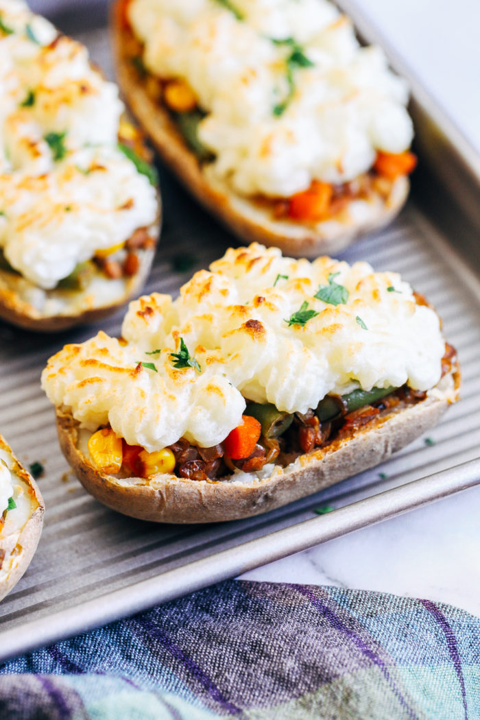 Twice Baked Lentil Shepherd's Pie Potatoes- a fun plant-based take on the Irish classic, these potatoes are stuffed with wholesome lentils and veggies for an easy and delicious meal! (gluten-free)
