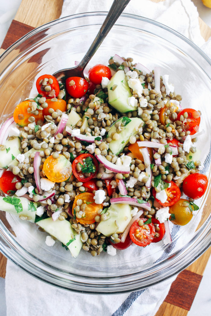 Lentil Cucumber & Tomato Salad- summer's best vegetables tossed in a tangy lemon dressing. Served with fresh herbs, it makes for a light and refreshing summer meal!