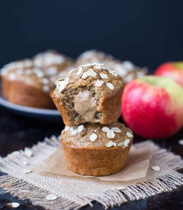 Healthy Apple Almond Butter Muffins- made with whole grain oats, applesauce, fresh apples and almond butter. Only 168 calories per muffin! #glutenfree #dairyfree