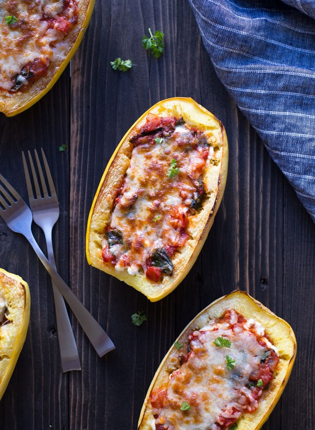 Spaghetti Squash Bowls stuffed with marinara, kale and cottage cheese make for a healthy and comforting meal that's high in protein and low in carbs! #glutenfree #grainfree