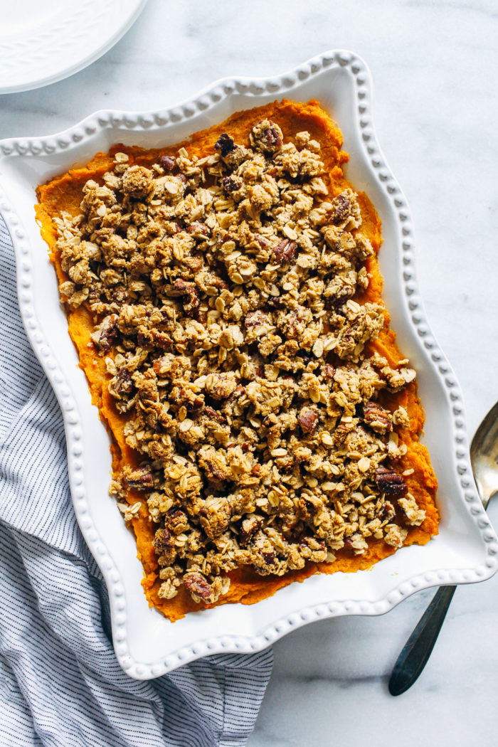 Butternut Squash and Sweet Potato Casserole with Pecan Crumble- butternut squash lightens up the traditional texture of sweet potato casserole and gets topped with delicious clusters of pecan crumble. Altogether it makes for one irresistible side item! (vegan and gluten-free)