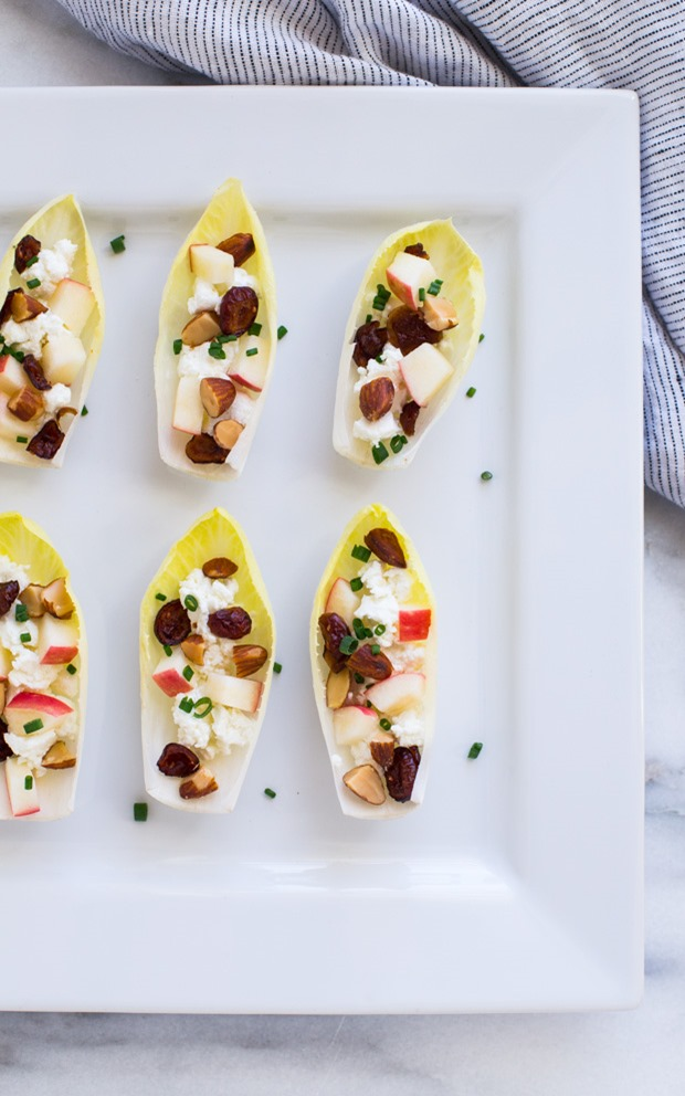 Endive leaves filled with crisp apples, creamy goat cheese, and crunchy smoked almonds make for an easy and delicious appetizer that everyone will love!