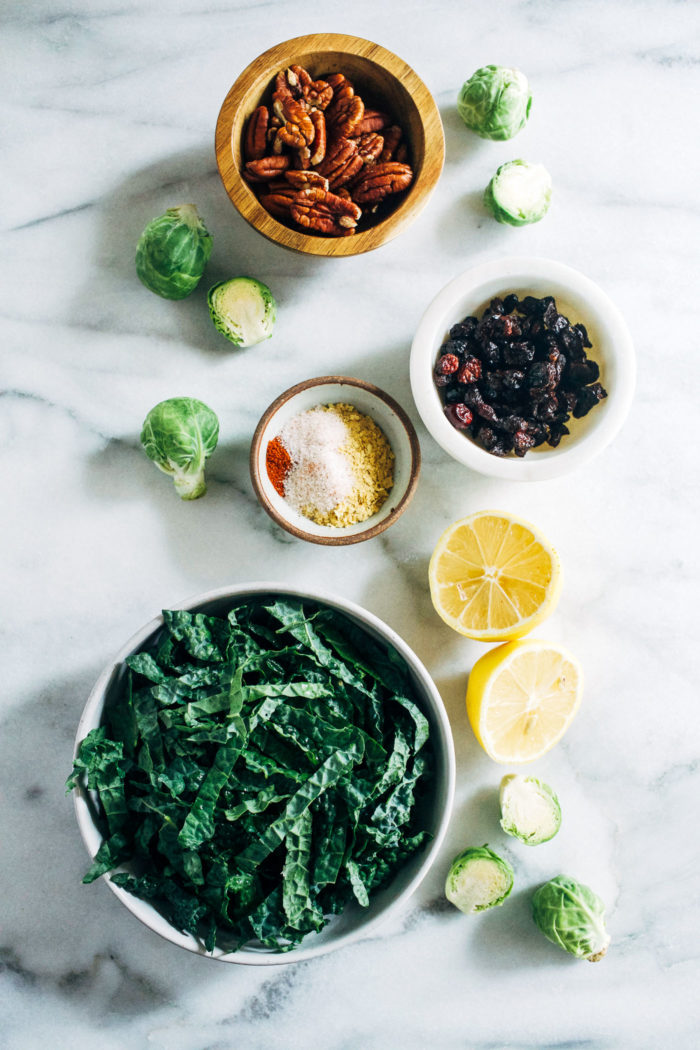 Shredded Brussels Sprout and Kale Salad with Maple Pecan Parmesan- this salad is robust and flavorful, making it perfect to prep ahead forthe holidays or healthy lunches during the week! (vegan + gluten-free)