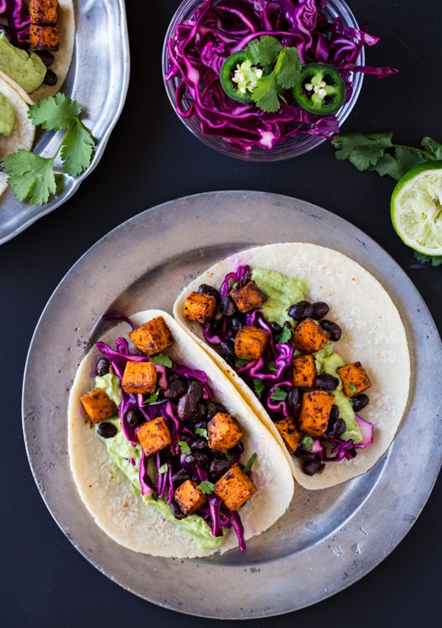 Chipotle Sweet Potato Tacos with Avocado Cream- a simple meatless meal that's packed full of southwestern flavor. Vegan + gluten-free.
