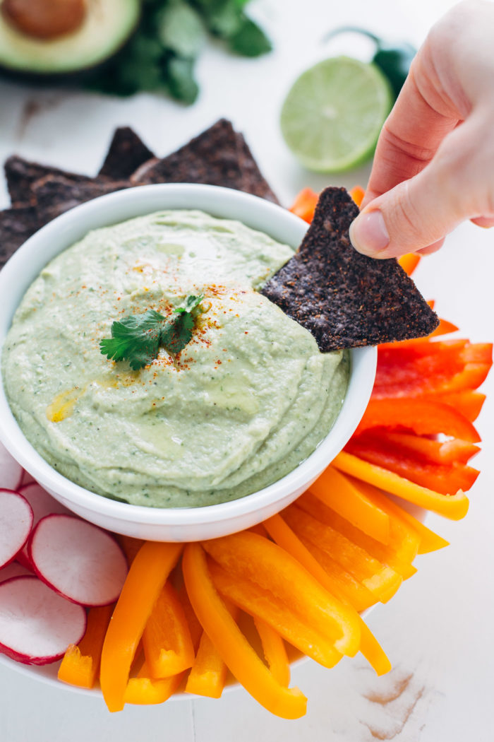 This creamy avocado hummus is packed full of flavor from fresh citrus, jalapeno, garlic and herbs. It's perfect for entertaining or for healthy snacks!
