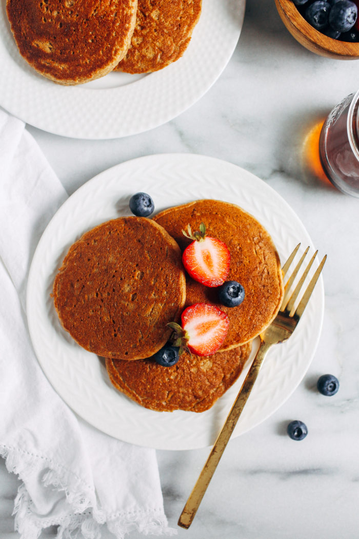 The Best Vegan Oatmeal Blender Pancakes- so light and fluffy, you would never guess they're made without dairy,  eggs, or gluten. And you probably have everything you need in your pantry to make them!
