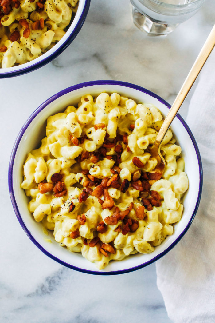 "Cauliflower Macaroni and ""Cheese"" with Tempeh Bacon Bits- a healthy vegan take on the classic comfort food made with pureed cauliflower, turmeric and nutritional yeast. It's so rich and creamy you would never guess it's dairy-free!"
