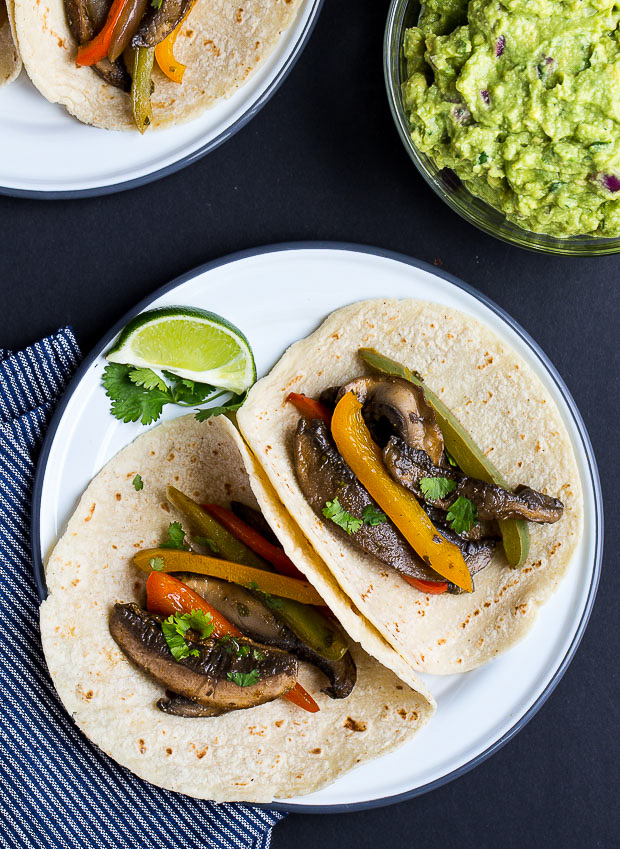 Portabella Mushroom Fajitas- portabella mushrooms cooked with peppers and onions in a chipotle-lime marinade. Super easy to make and ready in just 30 minutes! (vegan + gluten-free)