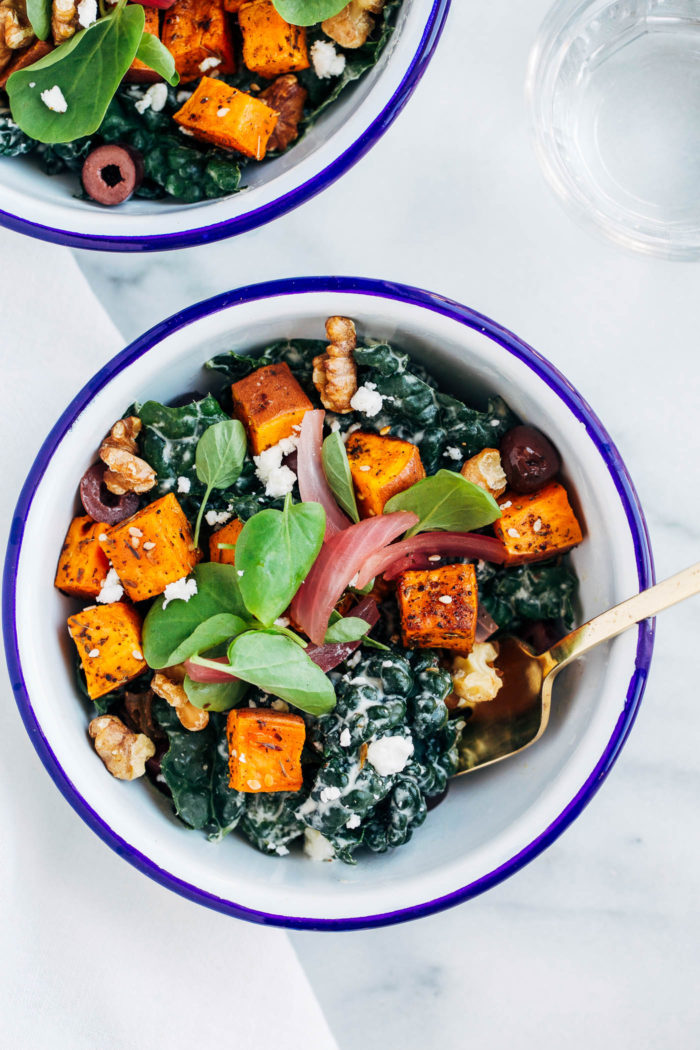 Sweet Potato Souvlaki Bowls- kale tossed with garlic, lemon and yogurt dressing topped with za'atar roasted sweet potatoes. So flavorful and healthy too! (vegetarian and gluten-free with vegan option)