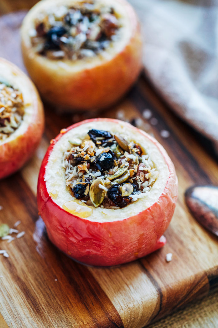Almond Butter Baked Apples- sweet baked apples stuffed with vanilla almond butter, pecans, cinnamon and drizzled with pure maple syrup. Makes for a delicious guilt-free snack or dessert! (vegan + gluten-free)