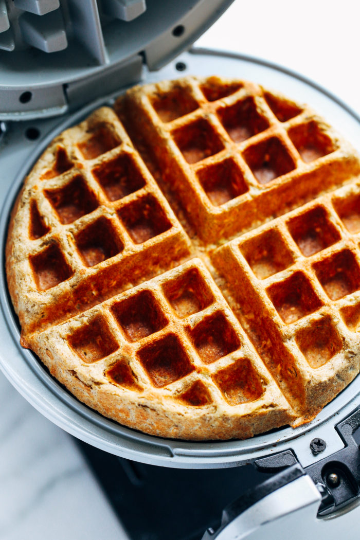 Apple Cinnamon Oatmeal Waffles- whole grain waffles with perfectly crisp edges. Made with rolled oats and shredded apple. (gluten-free and dairy-free)