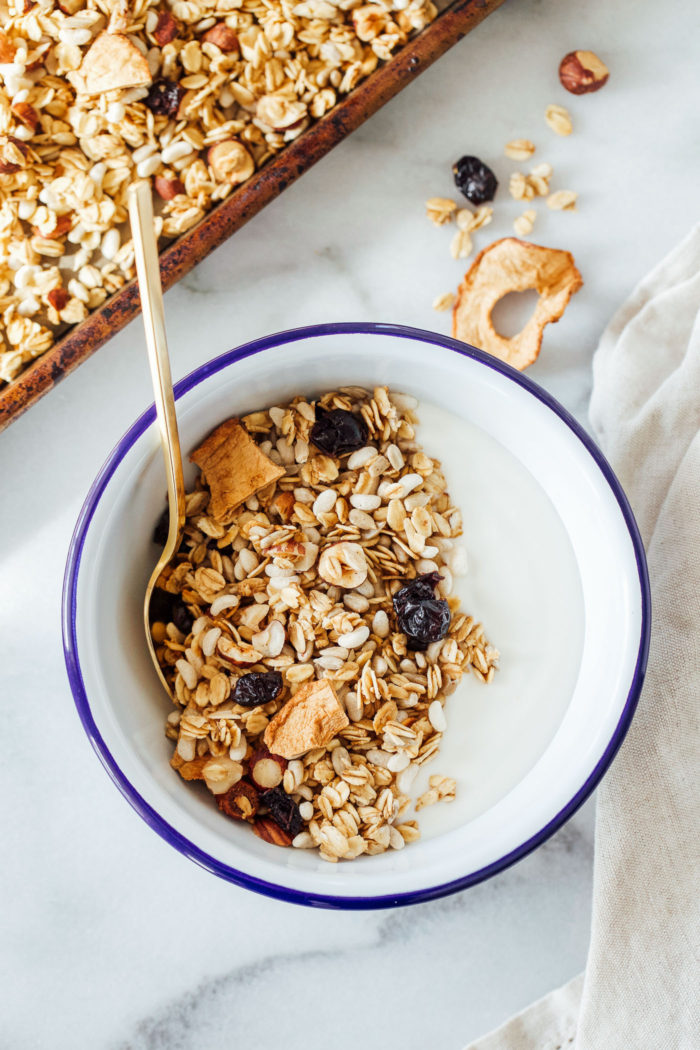 Apple Cinnamon Granola with Hazelnuts and Cranberries- a hearty granola that's bursting with flavor and texture. Gluten-free, vegan and refined sugar-free!