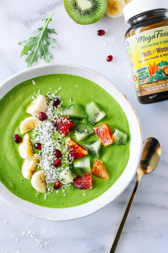 Glowing Green Smoothie Bowl- a tropical blend of mango, pineapple, banana, carrots, and kale. Packed full of vitamins and minerals to keep your skin glowing through winter!