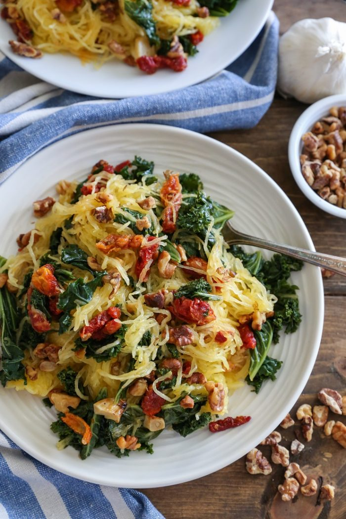 Roasted Garlic Kale Spaghetti Squash with Sun-Dried Tomatoes from The Roasted Root