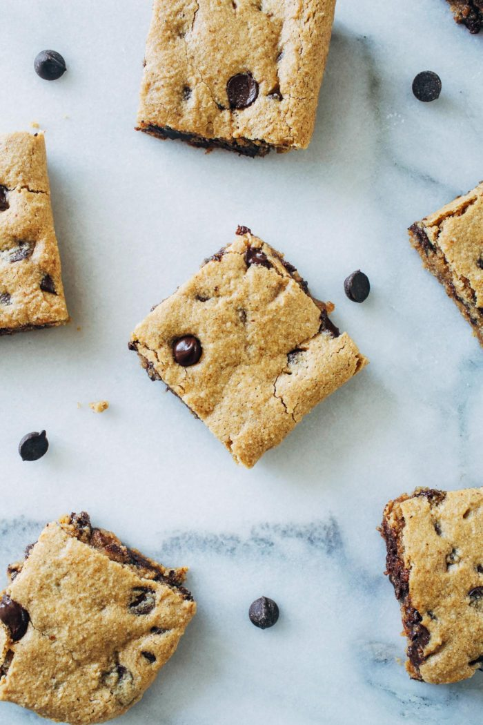 Almond Butter Cookie Bars- soft and chewy, these cookie bars are the perfect cure when you're feeling to lazy to roll the dough into individual balls. Just 20 minutes to make! (vegan, gluten-free + refined sugar-free)