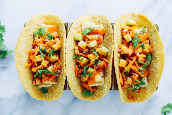 Crispy Tofu Bahn Mi Tacos- crispy tofu with pickled cucumber and carrots topped with a creamy sriracha sauce. (vegan + gluten-free)