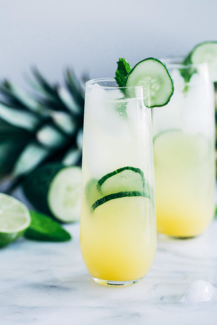Pineapple Cucumber Lime Spritzers- pineapple juice served with cucumber, lime, and mint infused sparkling water makes for a light and refreshing drink that's perfect for summer!
