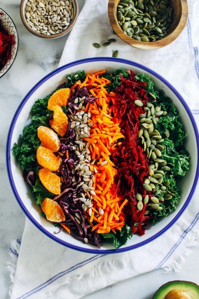 Renewing Rainbow Kale Salad- a vibrant and energizing salad that's a nutritional powerhouse. Each serving packs in 18 grams of protein! (vegan, nut-free and gluten-free)