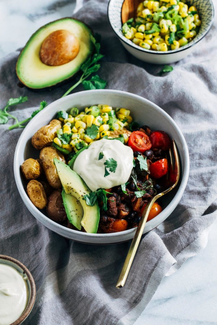 Roasted Potato Burrito Bowls- crispy roasted potatoes stand-in for rice in this satisfying Mexican-inspired dish. Each bowl has 21 grams of protein and 25% of the RDV of iron! (vegan, gluten-free + grain-free)
