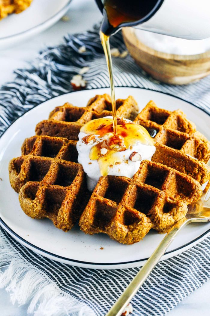 Flourless Vegan Pumpkin Oatmeal Waffles- made with rolled oats and pumpkin puree, these waffles are hearty, satisfying and perfect for fall. Don't have a waffle maker? The recipe makes delicious pancakes too! (vegan, gluten-free + oil-free)