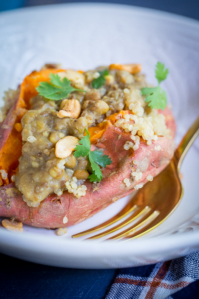 Curried Lentil & Quinoa Stuffed Sweet Potatoes from She Likes Food