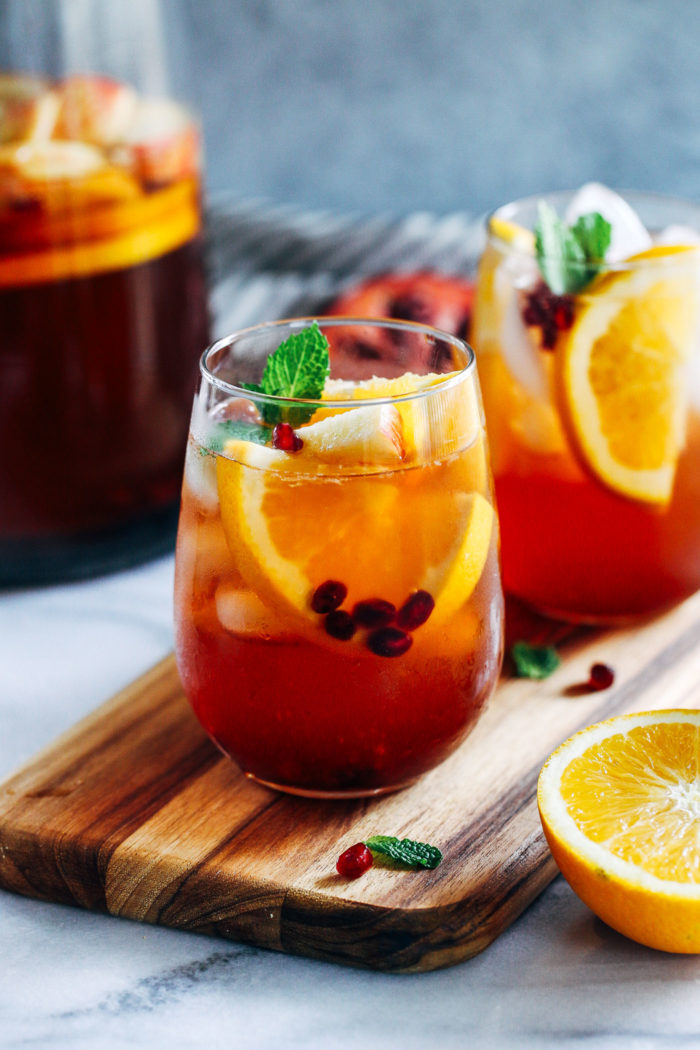 Sparkling Pomegranate Orange Sangria- a delicious and festive drink made with a combination of white wine, pomegranate juice, oranges, and champagne. Perfect for celebrating the holidays!