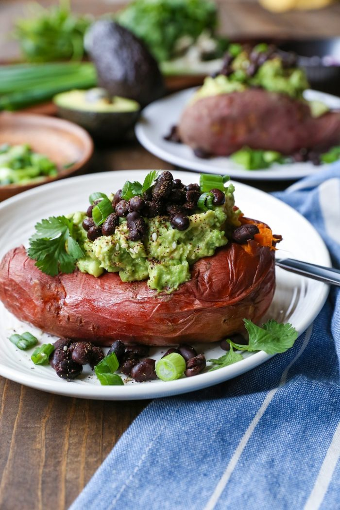 Guacamole and Black Bean Loaded Sweet Potatoes from The Roasted Root
