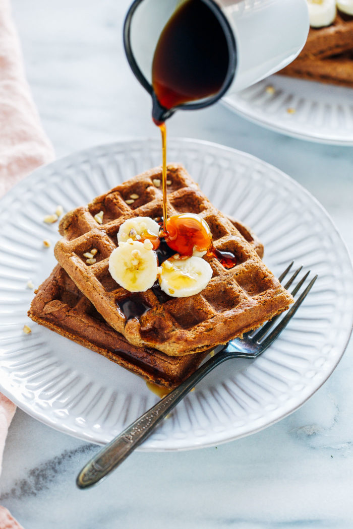 Flourless Vegan Banana Bread Waffles- made easy in a blender, these gluten-free waffles are naturally sweetened and full of flavor. They freeze well too, making them perfect to prep for weekday mornings!