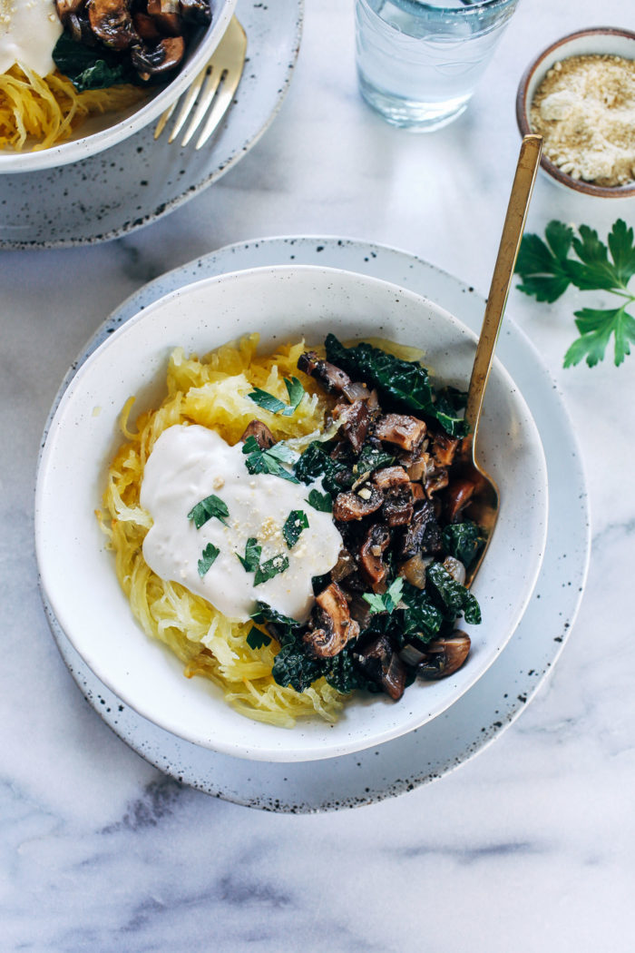 Spaghetti Squash with Mushrooms, Kale and Cashew Alfredo- roasted spaghetti squash is topped with balsamic mushrooms, garlicky kale, and creamy cashew alfredo. The perfect healthy comfort food!