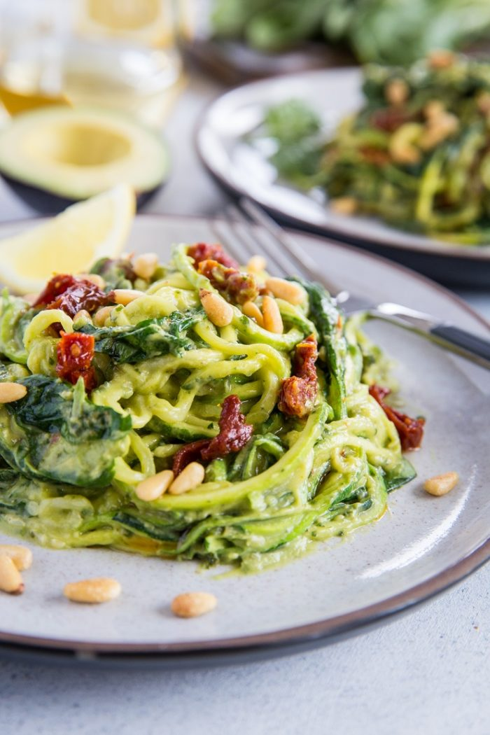 Avocado Pesto Zoodles with Spinach and Sun-Dried Tomatoes from The Roasted Root