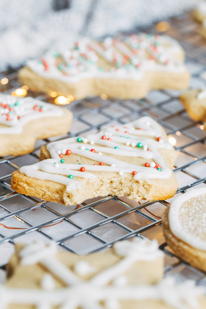 Vegan and Gluten-free Sugar Cookies- made with buttery almond flour, these cookies have crisp edges and a delicious chewy center. They're super simple to make and no one would ever guess they are made with healthier ingredients!