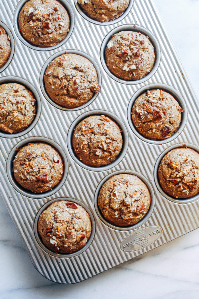Healthy Flourless Morning Glory Muffins- packed full of healthy ingredients, these muffins make a perfect on-the-go breakfast or snack. They also happen to be gluten-free, oil-free, dairy-free, and refined sugar-free!