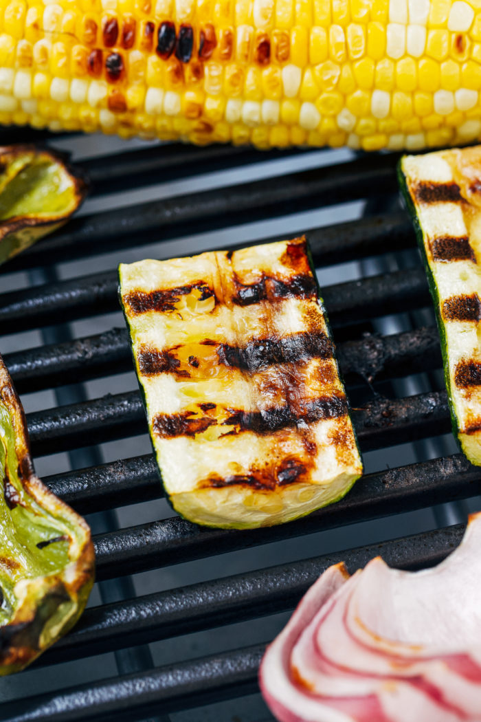 Grilled Summer Vegetable Tacos- summer's best veggies grilled and served with seasons black beans. Topped with a creamycilantro sauce and just 30 minutes to make! (vegan + GF option)