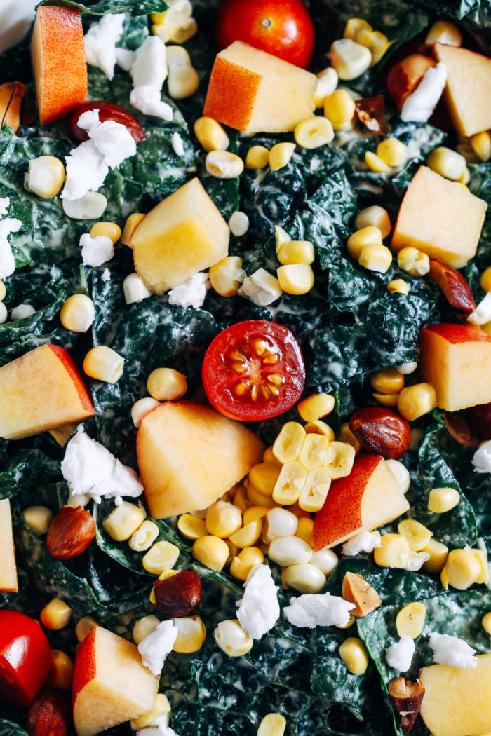 Summer Kale Salad- massaged kale gets topped with fresh nectarines, tomatoes and corn for a light and refreshing salad that's perfect for entertaining or prepping for lunches!