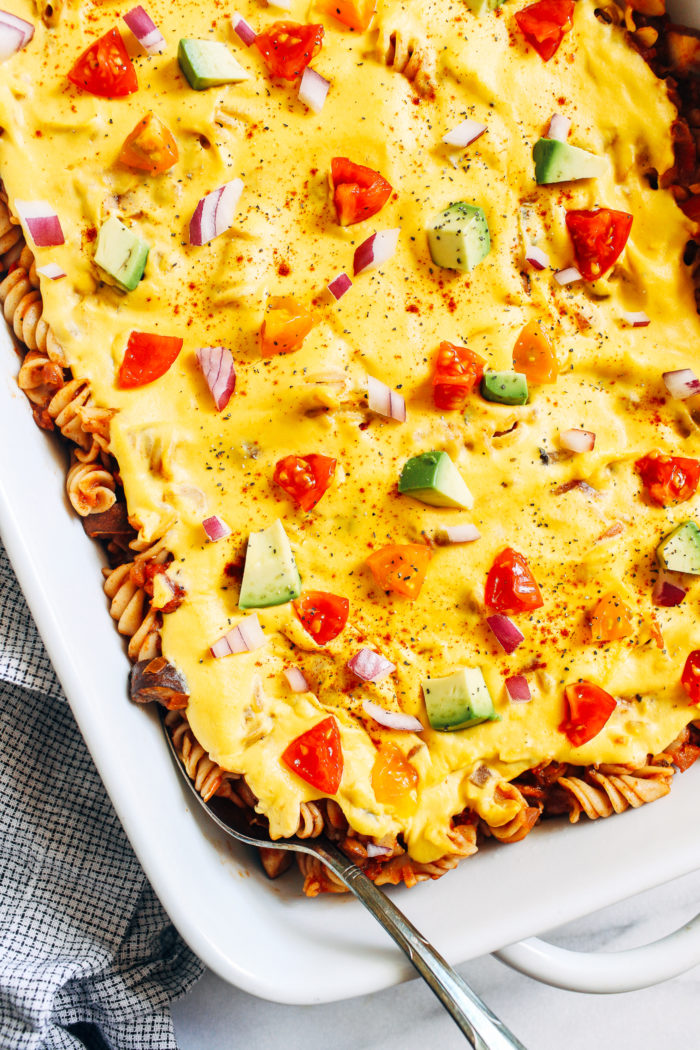'Cheesy' Lentil Chili Casserole- spiral pasta layered with savory lentil chili and a creamy cheese sauce. Hearty and satisfying, it's the perfect healthy comfort food!#vegan #plantbased #glutenfree