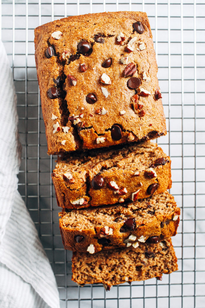 Vegan Almond Butter Banana Bread- Naturally sweetened and oil-free, this banana bread is the perfect treat to have on hand for a quick breakfast or healthy snack. Each slice contains 6 grams of protein!