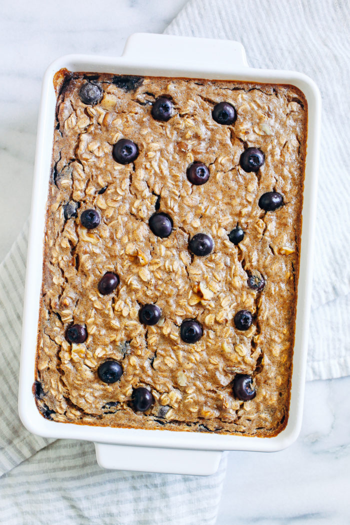 Blueberry Banana Baked Oatmeal- this healthy make-ahead breakfast comes together fast and tastes just like banana bread. Each serving packs 10 grams of plant-based protein! (vegan + gluten-free)