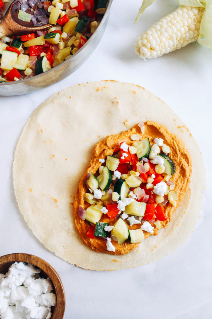 Summer Vegetable Hummus Quesadillas- made with zucchini, corn, and bell pepper, these quesadillas are the perfect quick and easy summer meal! #vegan