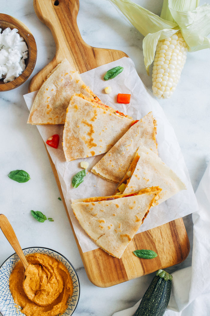 Summer Vegetable Hummus Quesadillas- made with zucchini, corn, and bell pepper, these quesadillas are the perfect quick and easy summer meal! #vegan #glutenfree #plantbased