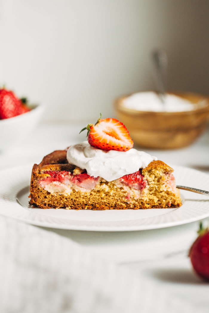 Perfect Strawberry Cake- fresh strawberries are tucked inside of buttery vanilla cake batter and baked to golden perfection. So simple to make and perfect for summertime! (gluten-free and dairy-free)